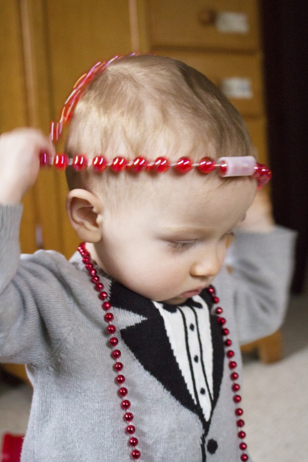toddler with red necklace